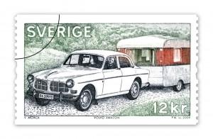 Frimärke med Volvo Amazon och husvagn